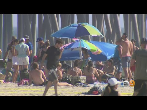 Beachgoers Enjoy Warm Day On Huntington Beach To Kick Off Memorial Day Weekend
