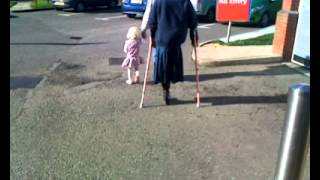 LADY IN A SUSSEX CAR PARK, HOPPING ON CRUTCHES WITH ONE LEG