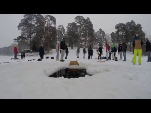 Winter Swim & Ice Hole sit in Latvia in minus 7 degrees celsium with participant record in Riga