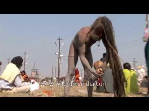 Sadhu applies human ash on his body during Kumbh Mela, India