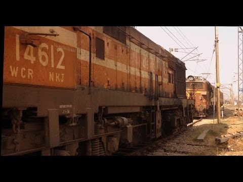 INDIAN RAILWAYS Hilarious ! Poor diesel chased into siding by dual Electrics at TKD yard