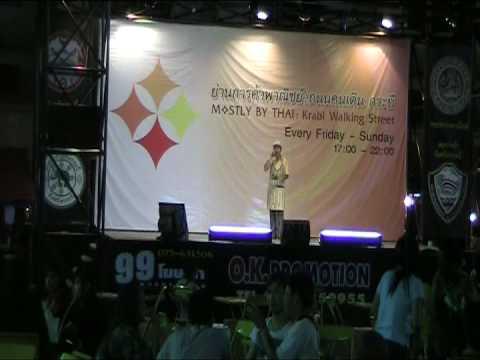 Karaoke in Krabi Walking Street (market). Thai performance.