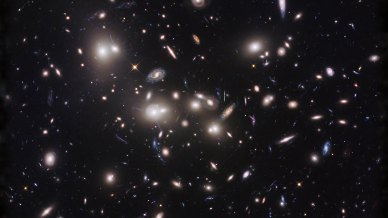 HubbleSite: Video - Zoom into the Massive Galaxy Cluster Abell 2744