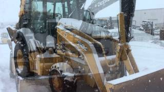 John Deere construction equipment in the snow