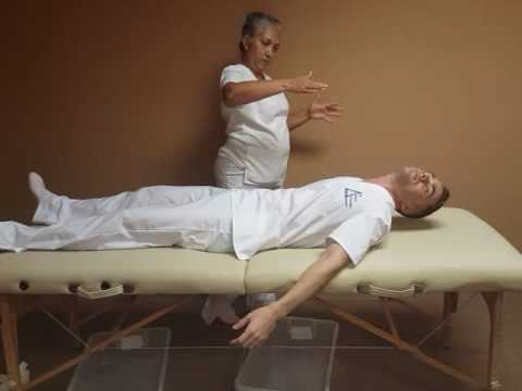Lauradis Salas With Inier Oliva During A  REIKI Session.