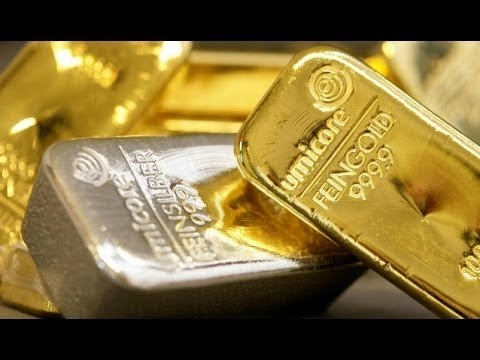 Gold Slips on Lower Demand, Silver Surges