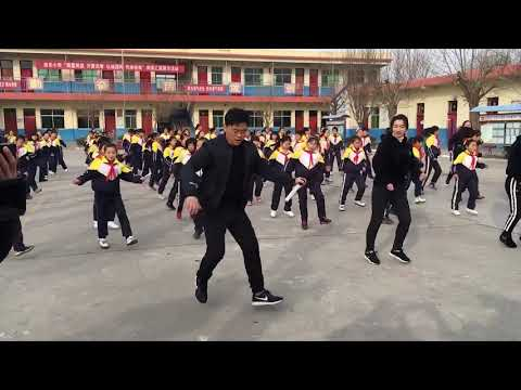 School Principal Shuffles As He Leads Students In Dance Routine