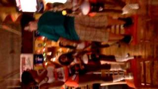 Kid dancing on a stool at Hooters