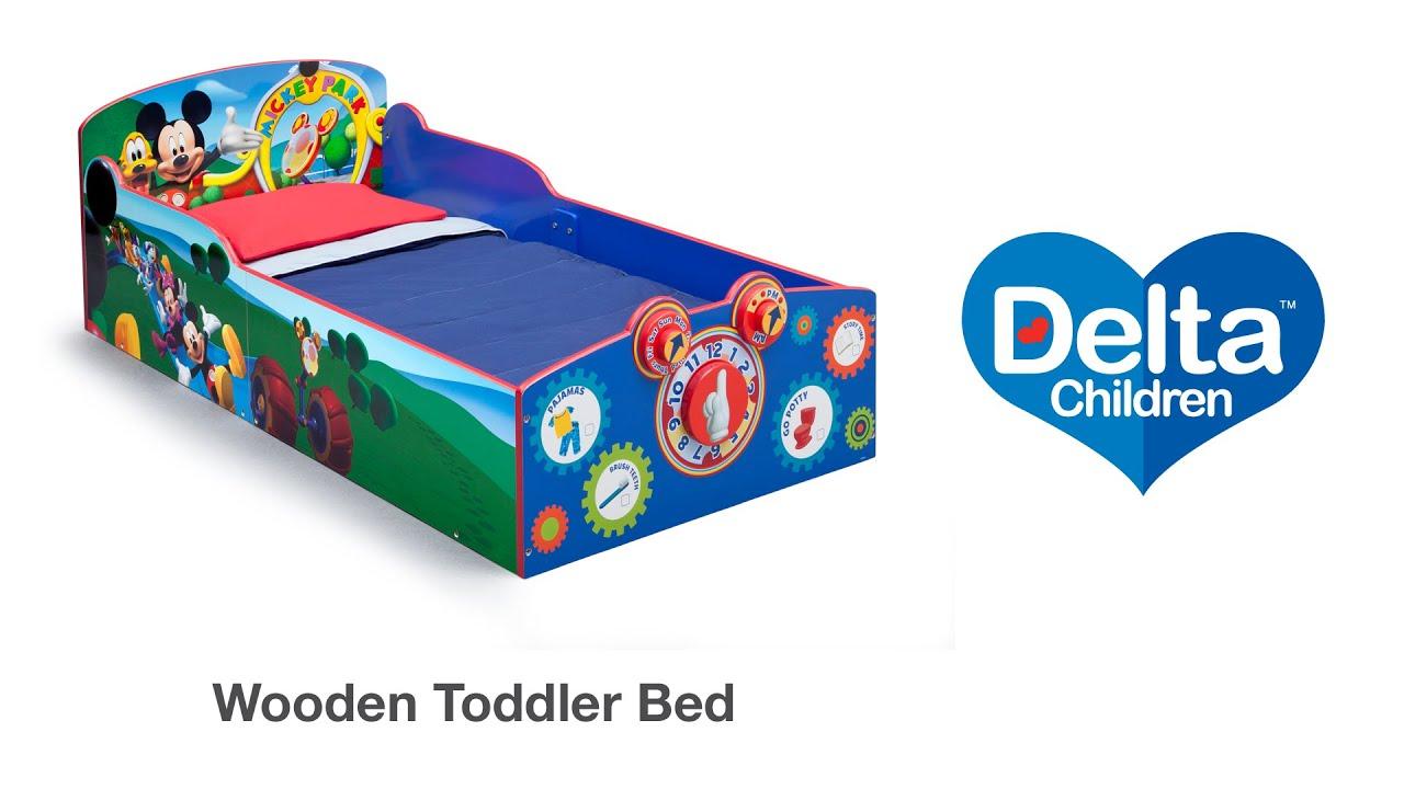 delta interactive wood toddler bed vignette