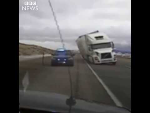 Strong winds blow truck onto car