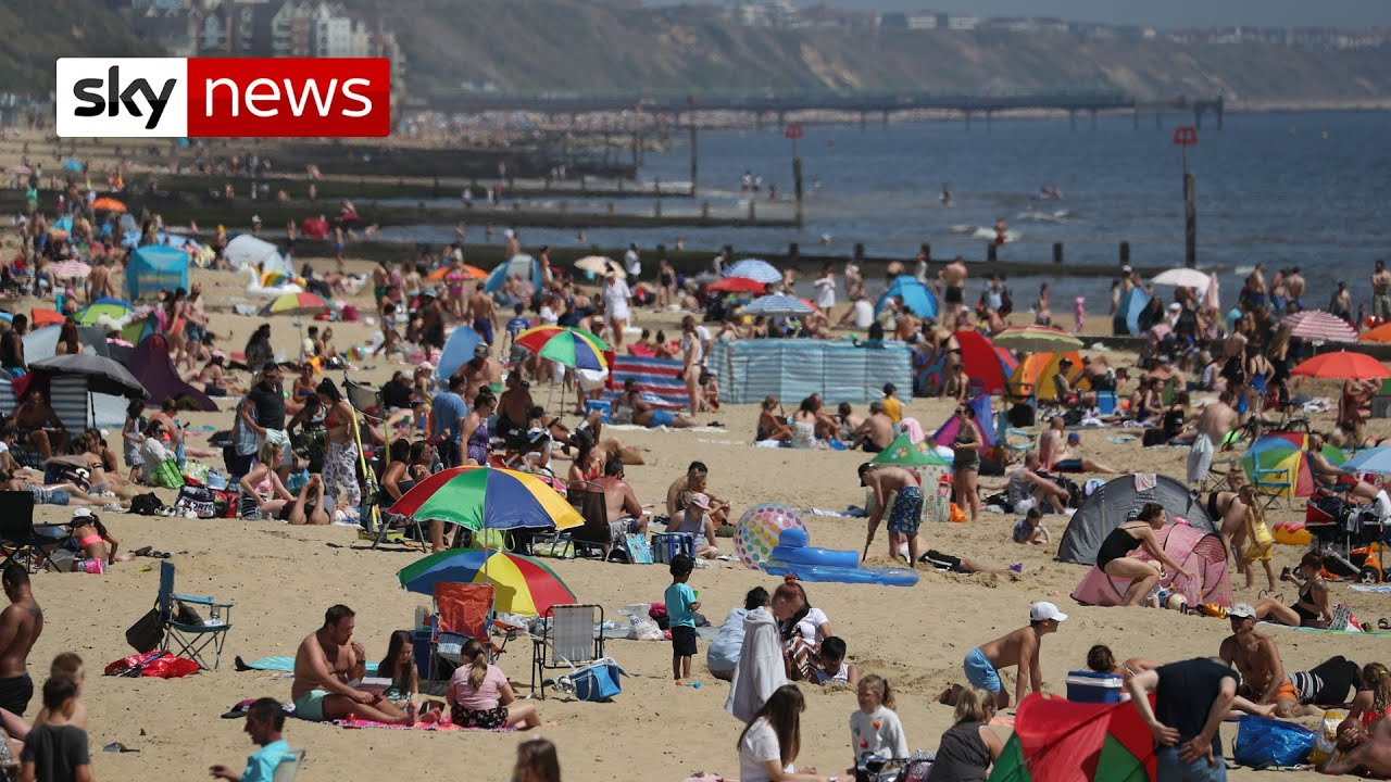 Thousands flock to beaches on UK's hottest day despite COVID-19 warnings