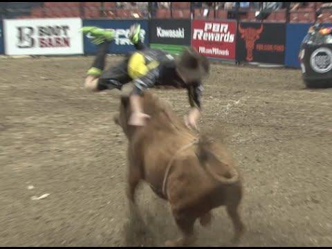 Bullfighter jumps over charging bull