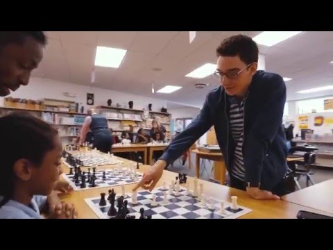 School kids playing simul with Chess Grandmasters