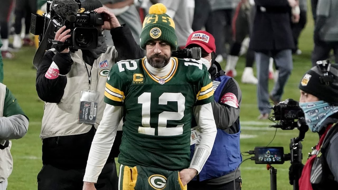 Packers QB Aaron Rodgers reports to Training Camp after standoff ...