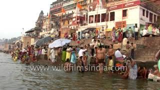 People take holy dip in the river Ganges, Varanasi