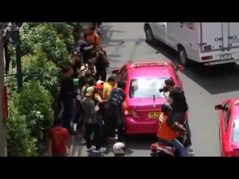 Anti coup protester forced into taxi   Bangkok Post  multimedia mp4