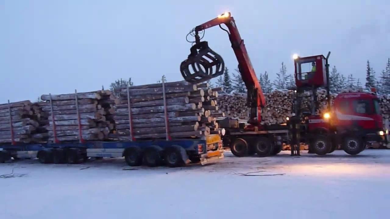 Timber Loading Lastning av ETT ekipaget med separatlastare ...