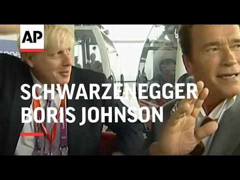 Arnold Schwarzenegger and London Mayor Boris Johnson ride cable car at Olympics