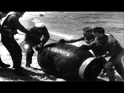 Underwater Demolition Team members push a mine onto a coast off the coast in Kore...HD Stock Footage