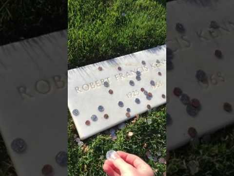 Laying a coin on Robert Kennedys Grave.