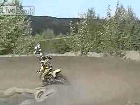 Female motocross rider in a head on collision with other rider