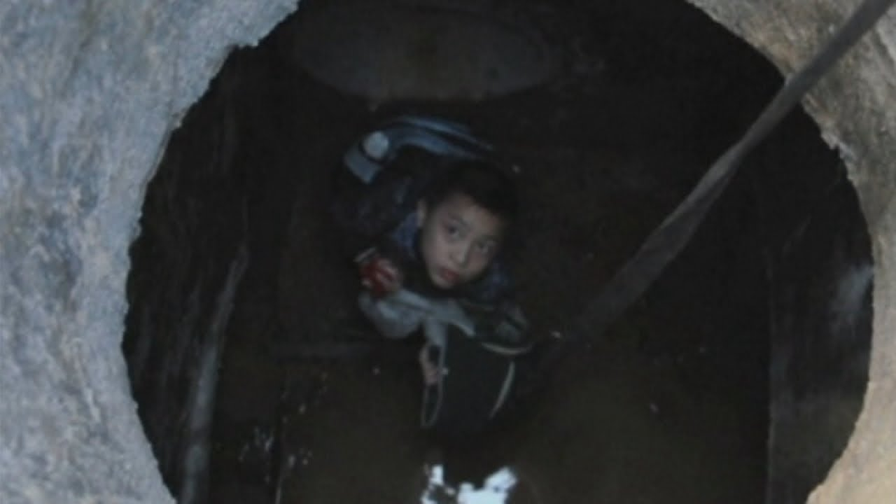 Boy rescued from sewer in China