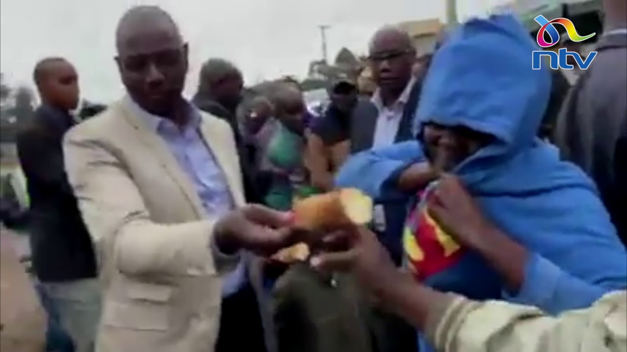 Woman goes down on her knees to thank DP Ruto after he bought maize from her