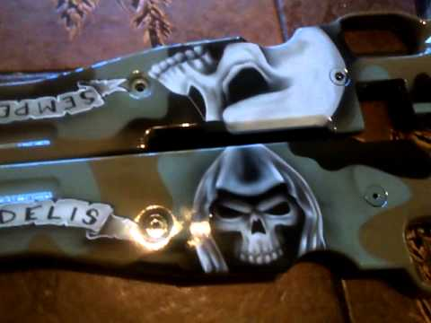 custom airbrushed rifle stock with Marine Corp designs and camo paint