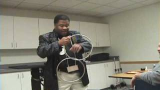 Dynamike, Detroit Magician Performing Chinese Linking Rings Magic Trick