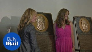 Brandi Chastain stands next to her soccer Hall of Fame plaque - Daily Mail
