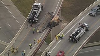 Raw: Construction Vehicle Dangles Off Turnpike