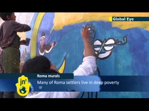 Roma artists decorate Hungarian homes with murals: many of EU's Roma communities live in poverty