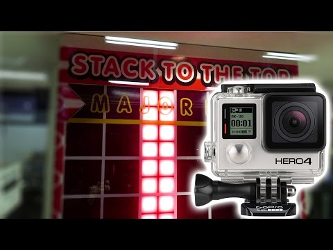 Can We Win a GoPro at a MEGA Stacker Arcade Game? |