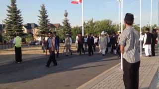 Huzoor (aba) passes by in Peace Village, Canada