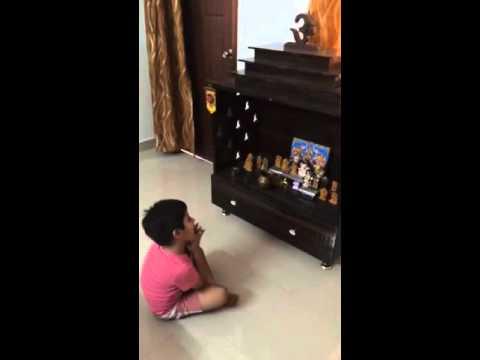 Cute indian kid praying for his homework
