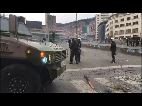AFP news agency: Bolivian police stand guard after violent clashes in La Paz | AFP