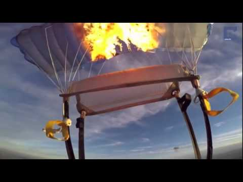 Skydiver Shoots Parachute With Flare Gun