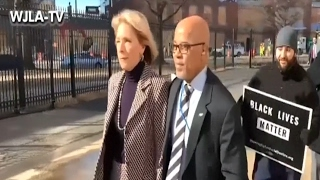 betsy devos is blocked by protesters from entering a school