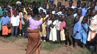 Uganda traditional dance by a young girl- AMAZING!