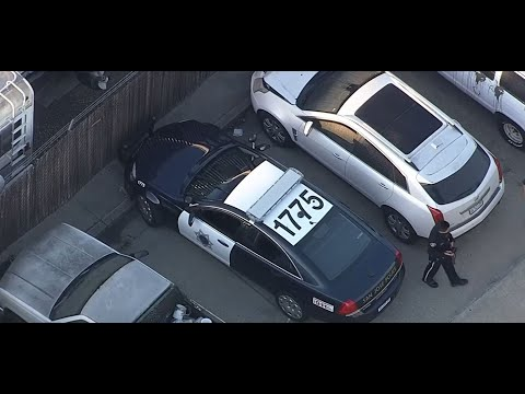 STOLEN POLICE CAR: Raw helicopter video of police recovering stolen
