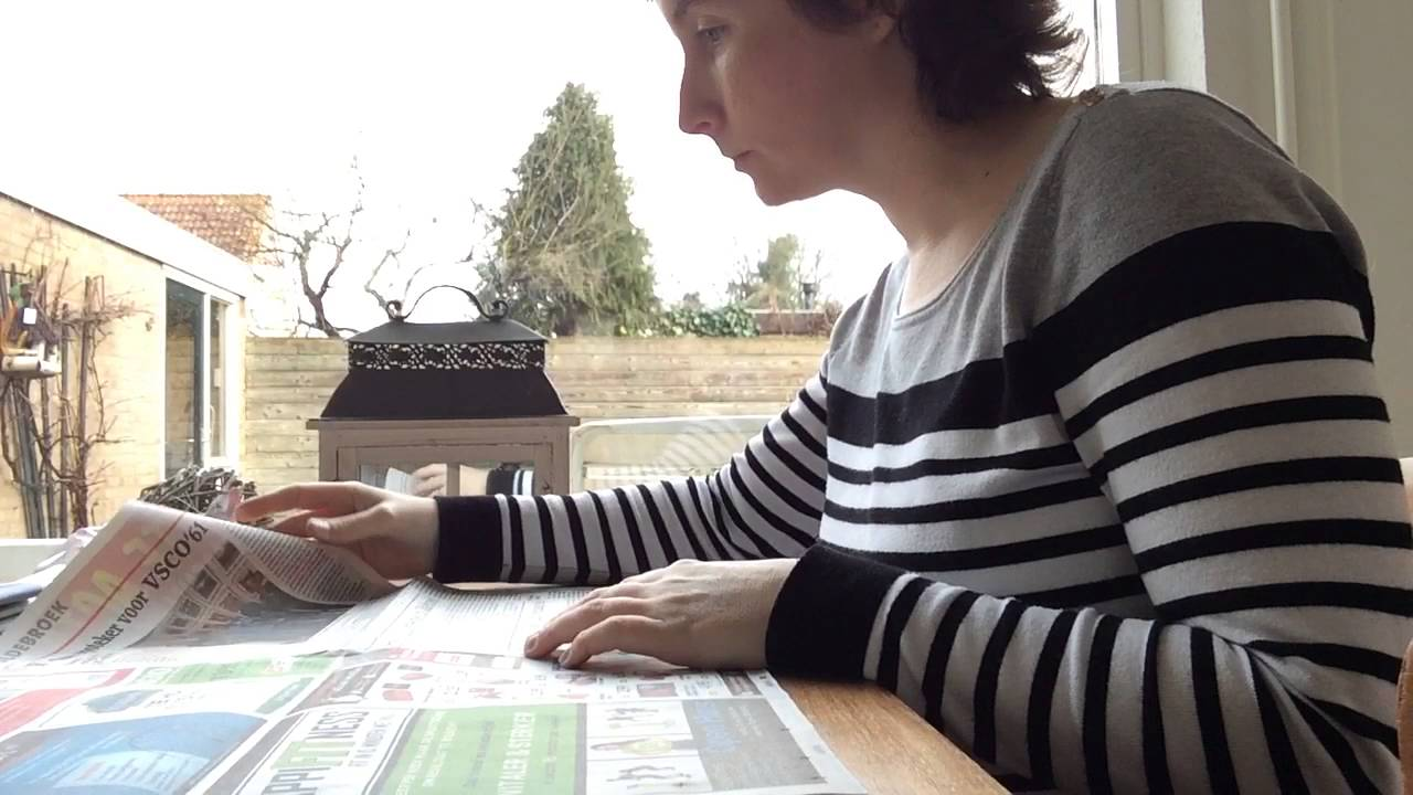 ASMR page turning newspapers with finger licking