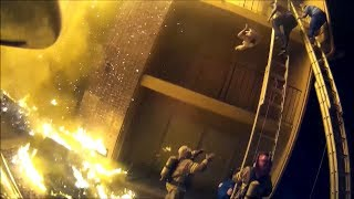 Firefighter catches child thrown from burning apartment during dramatic rescue