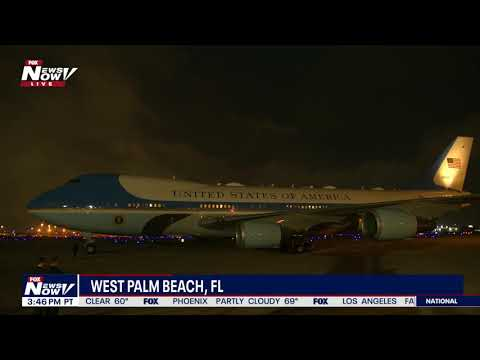 NIGHTTIME LANDING: Air Force One In West Palm Beach, Florida
