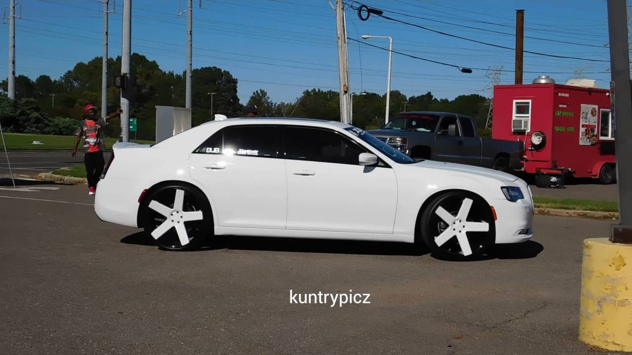 White Chrysler 300 on color match dub ballers & wrapped ...