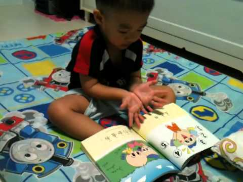 Darren Tong reading a Chinese Book (1/2)