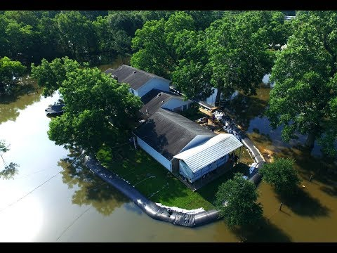 Neighbors Thought He Was Nuts For Adding 8K Worth Of Plastic To His Home  Until The Floods Came
