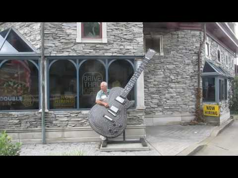 Henry playing a big guitar on the Country Music Highway in Kentucky