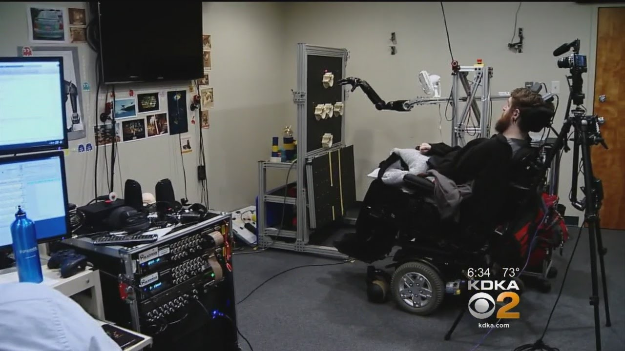 Mind-Controlled Robotic Arm Allows Paralyzed Man To Feel, Move Objects