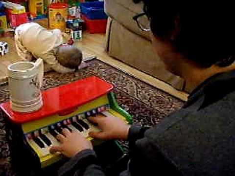 piano man jonathan on the melissa and doug toy piano