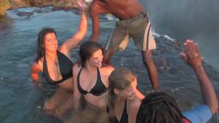 Girls defy death at Victoria Falls! Devil's Pool, Livingstone Island, Zambia(Livingstone island offers a view of Victoria Falls that is incomparable to any waterfall anywhere in the world. For the best in African holidays, destination ..., 2010-11-18T19:47:53.000Z)